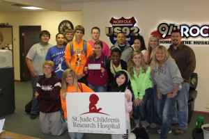 Norfolk High DECA presents check to US 92 and St. Judes Radiothon