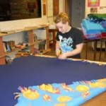 Vicki Klafter prepares blankets for children
