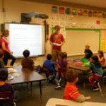 Kaitlyn Westcott and Keegan Melcher teach about community service